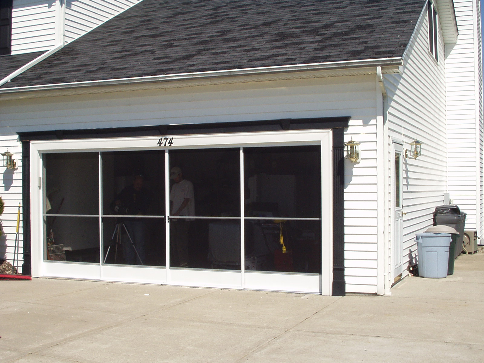 Garage screen door patio enclosure installation gallery for Roll down garage door screen